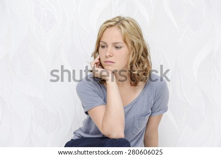 Young woman sitting thoughtful