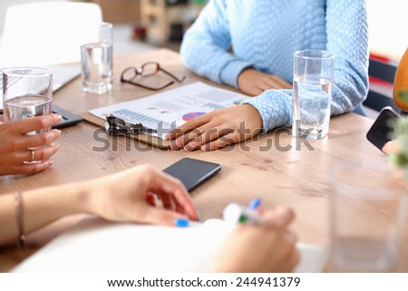 Young woman sitting with laptop  and holding  credit cart - stock photo