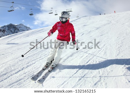 Young woman skiing. Alps - stock photo
