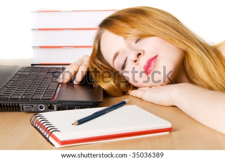 Young woman sleeping at her workplace - stock photo