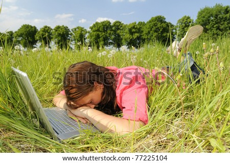 young woman sleeping on laptop - stock photo