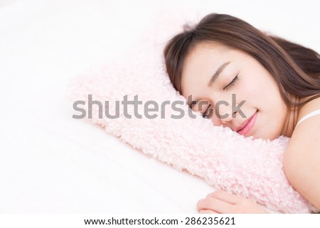 young woman sleeping on the bed - stock photo
