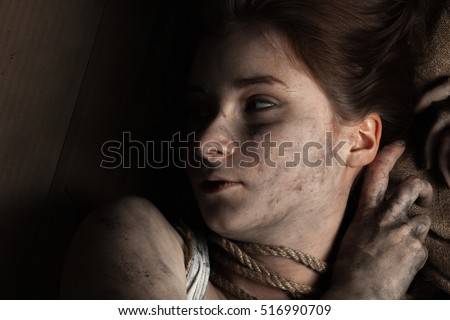 Young woman smeared soot with rope.