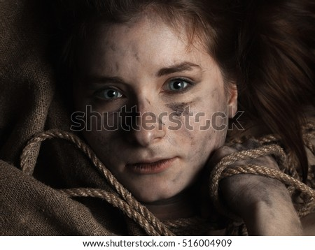Young woman smeared soot  with rope and jute cloth. Close up