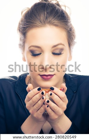 Young woman smelling hot coffee  - stock photo
