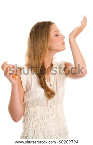 Young woman smelling perfume on wrist isolated on white background