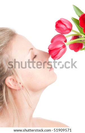 Young woman smells bunch of red tulip flowers. Isolated over white - stock photo