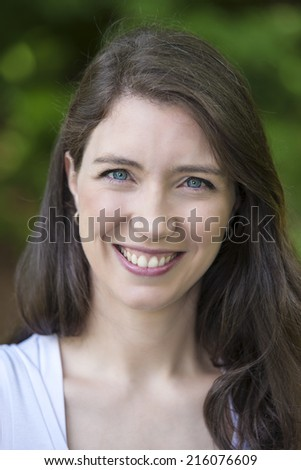 Young woman smiling at camera.