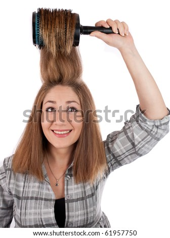 young woman smiling doing her hair,isolated on white