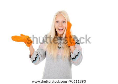 young woman smiling holding hand showing something on the open palm with empty copy space, wear winter knitted sweater and orange gloves, concept advertisement product, isolated over white background - stock photo