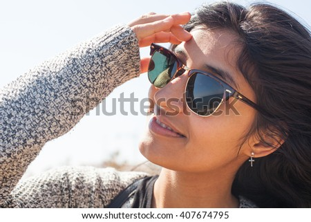 young woman smiling in the beach