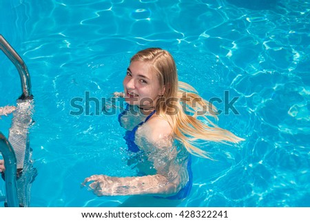 Young woman smiling in the swimming pool