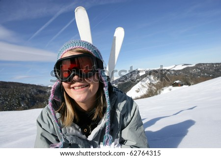 Young woman smiling wearing a ski mask - stock photo