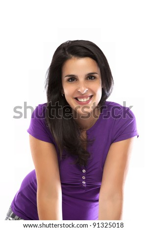 Young woman smiling with a violet t-shirt isolated on white - stock photo