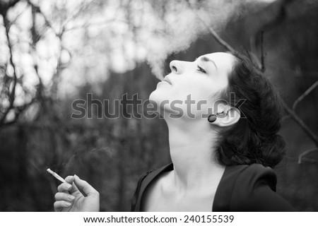 Young woman smoking - stock photo