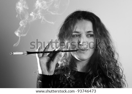 Young woman smoking - stock photo