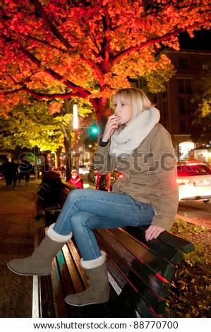 young woman smoking a cigarette - stock photo
