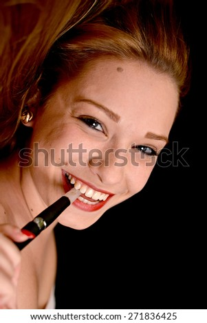 Young woman smoking electronic cigarette (e-cigarette) - stock photo