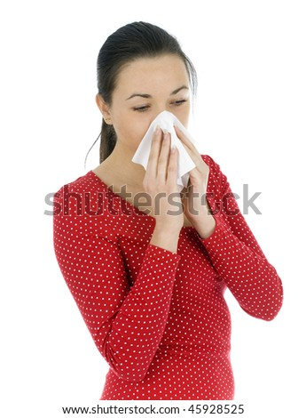 young woman sneezing to a paper handkerchief - stock photo