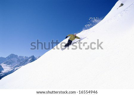 Young woman snowboarding - stock photo