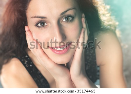 Young woman soft portrait. Multicoloured lights effect. - stock photo