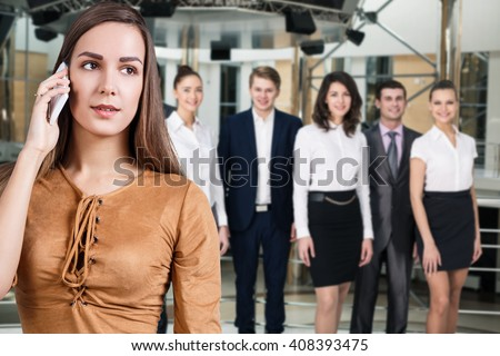 Young woman speak on the phone - stock photo