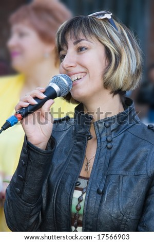 young woman-speaker - stock photo