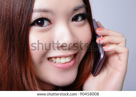 Young woman speaking cell phone with sweet smile, model is a asian beauty - stock photo
