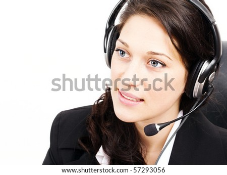 Young woman speaking on the phone working - stock photo