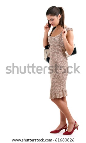 young woman speaks by a mobile phone