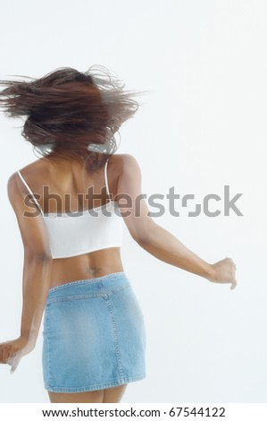 Young woman spinning - stock photo