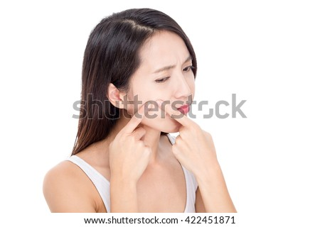 Young woman Squeezing pimple - stock photo