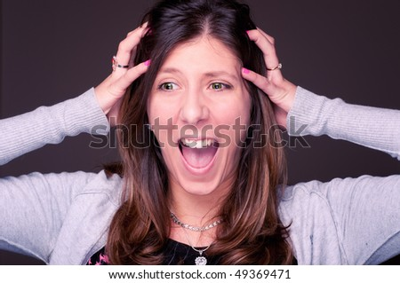 Young woman sreaming, hodling her head