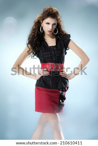 Young woman standing against on white background - stock photo