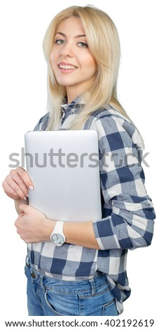 young woman standing and holding laptop