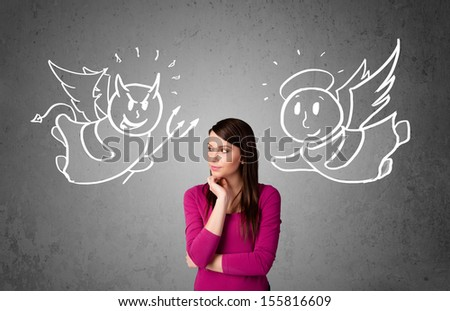 Young woman standing between the angel and the devil drawings - stock photo