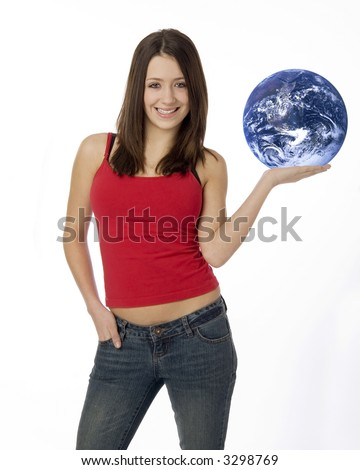 Young woman standing holding planet earth in the palm of her hand