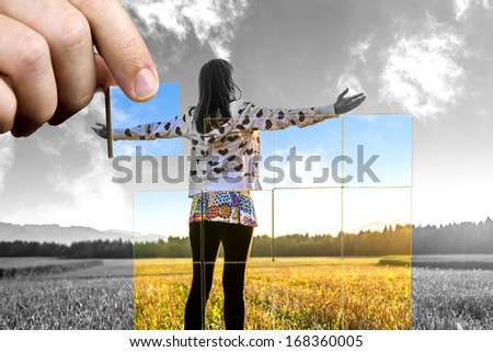Young woman standing on field with hands wide open. Concept of positive personal perspective toward life. - stock photo