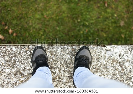 Young woman standing on the edge - stock photo