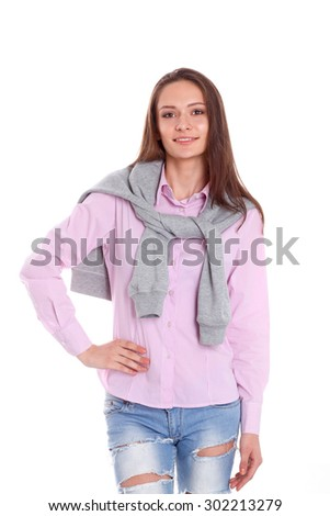 Young woman standing on the white background - stock photo
