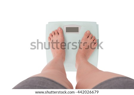 Young Woman Standing On Weighing Digital isolated on white background. Top View - stock photo