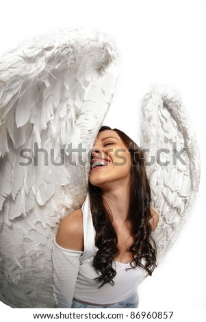 Young woman standing with angel wings isolated on white taken with wide angle lens - stock photo