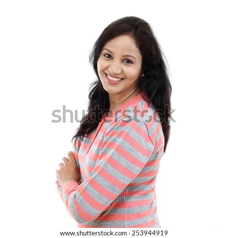 Young woman standing with arms crossed against white background      - stock photo