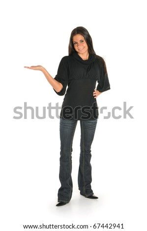 Young woman standing with hand out - stock photo