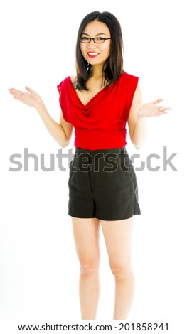 Young woman standing with her arm outstretched