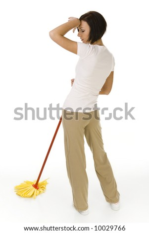 Young woman standing with mop. She's looks like exhausted. Whole body. Rear view. White background. - stock photo