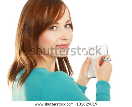 Young woman standing  with notebook, isolated on white background - stock photo