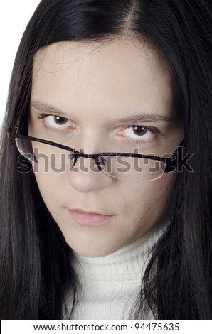 Young woman staring over her glasses - stock photo