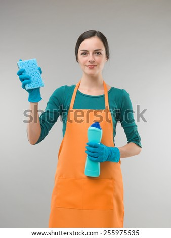 young woman starting spring cleaning - stock photo