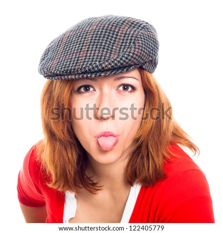 Young woman sticking out tongue, making funny faces, isolated on white background. - stock photo